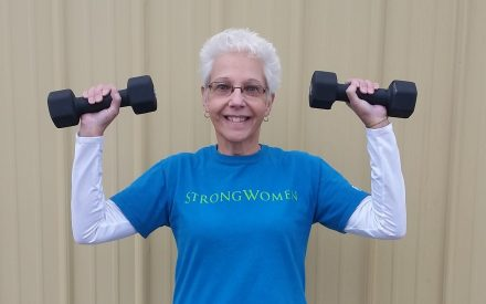 Deb Mulrain from Monroe County holding weights