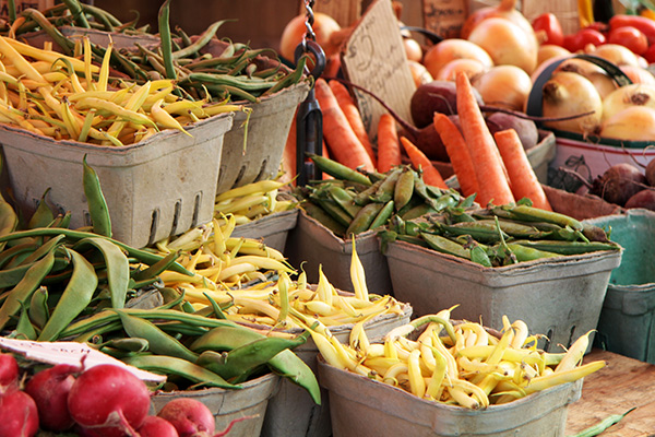 Containers of garden vegetables for sale at a farmers market
